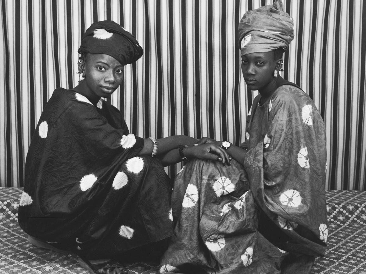 Deux amies Peulhs, printed in 2001 from an earlier negative. People loved to come to Sidibe's studio to show off their treasures — from fashionable garb to a beautiful smile.