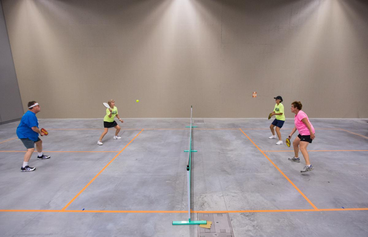 Mike Coats (left) and Rosemarie Pietromonaco return the ball to Beverly Miller and Diane Reynolds in a practice match of pickleball.