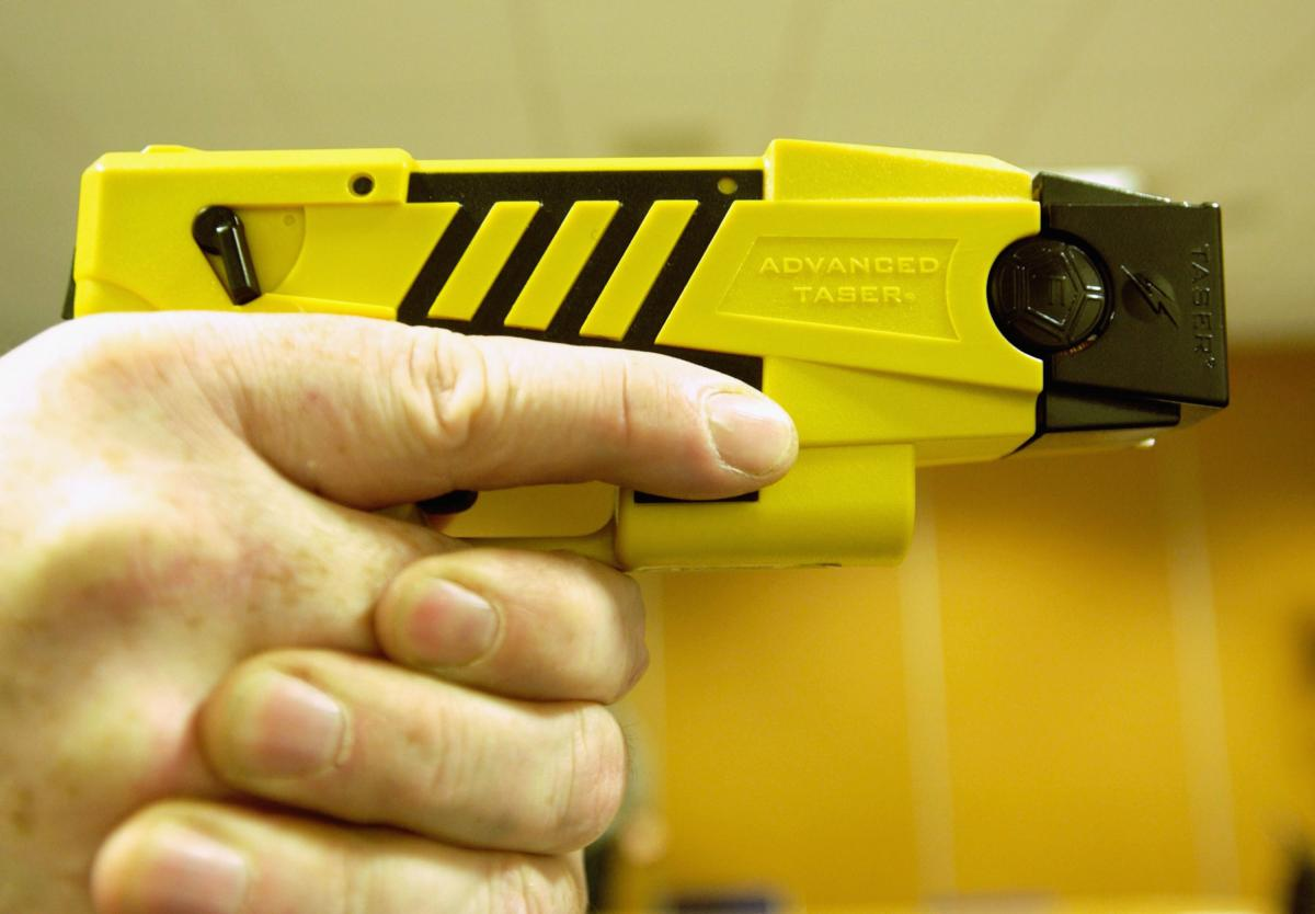 A policeman holds a stun gun on April 4, 2003.