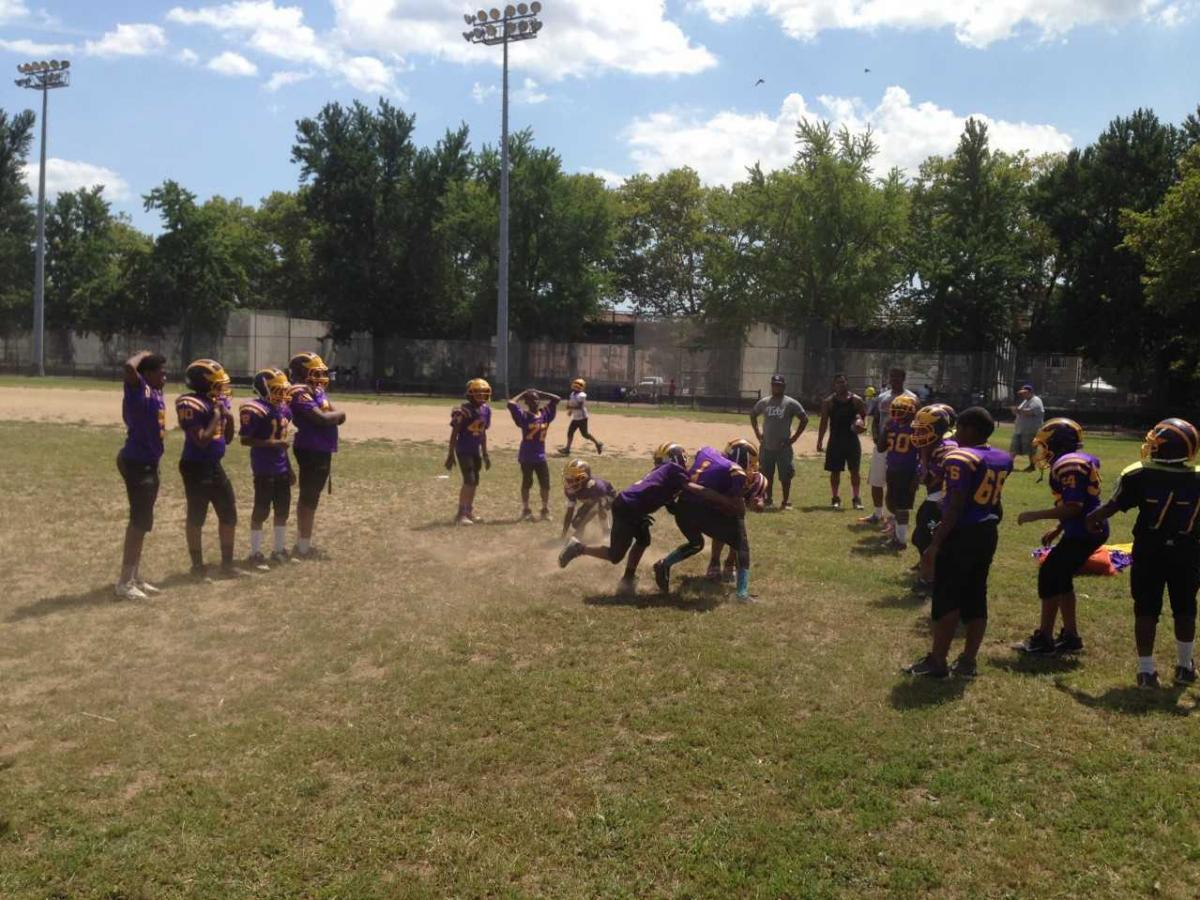 Boys on the Mo Better Jaguars Pee Wee football team collide during tackling drills on the first full-contact practice of the season in August 2014.