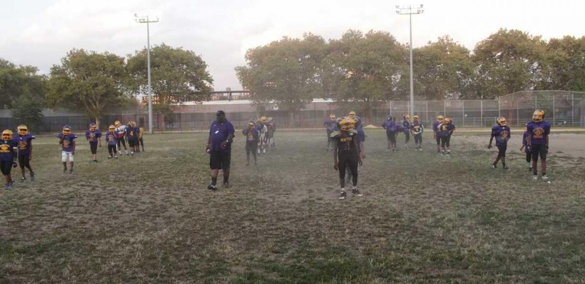 Boys on the Mo Better Jaguars youth football team line up for warm ups during practice in September 2014.