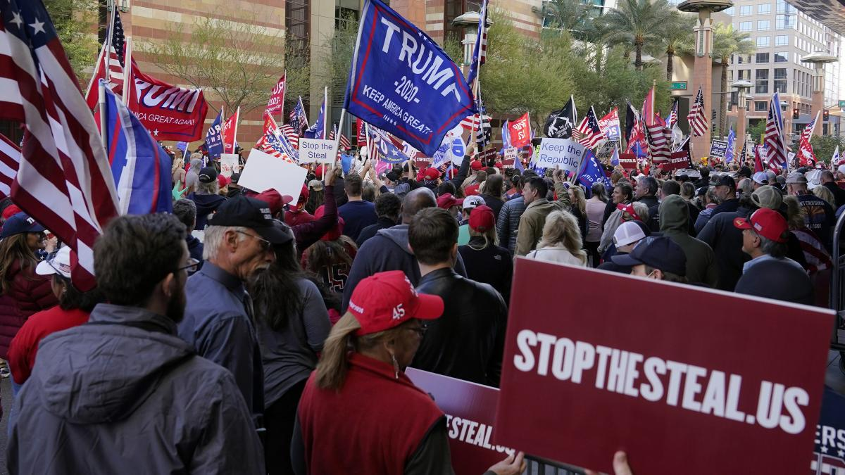 Trump supporters protest this week in front of a Phoenix hotel where Arizona Republicans had scheduled a meeting to discuss the election.