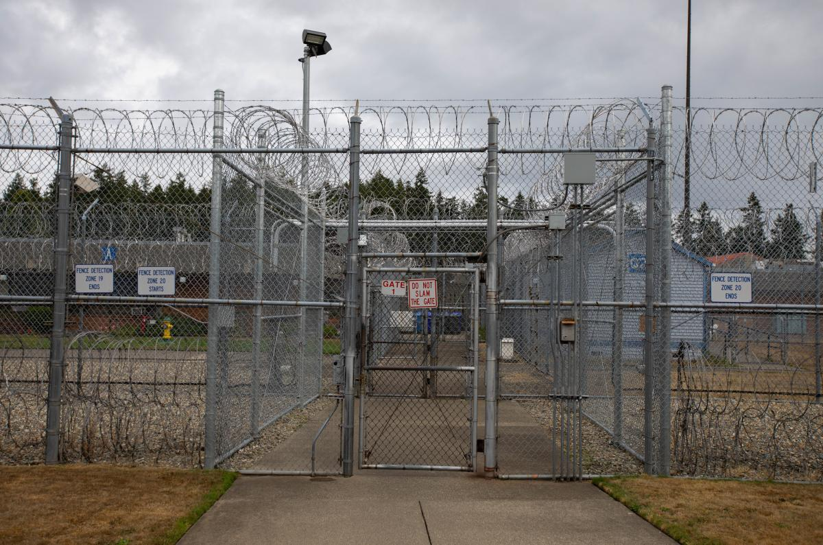 Razor wire-topped fences surround the maximum security building at the Washington Corrections Center for Women in Gig Harbor.