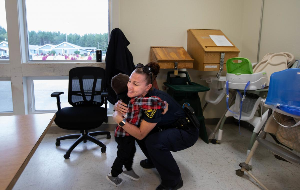 Kirshawn hugs a correctional officer in the cafeteria at the women's corrections center in Gig Harbor in Washington.