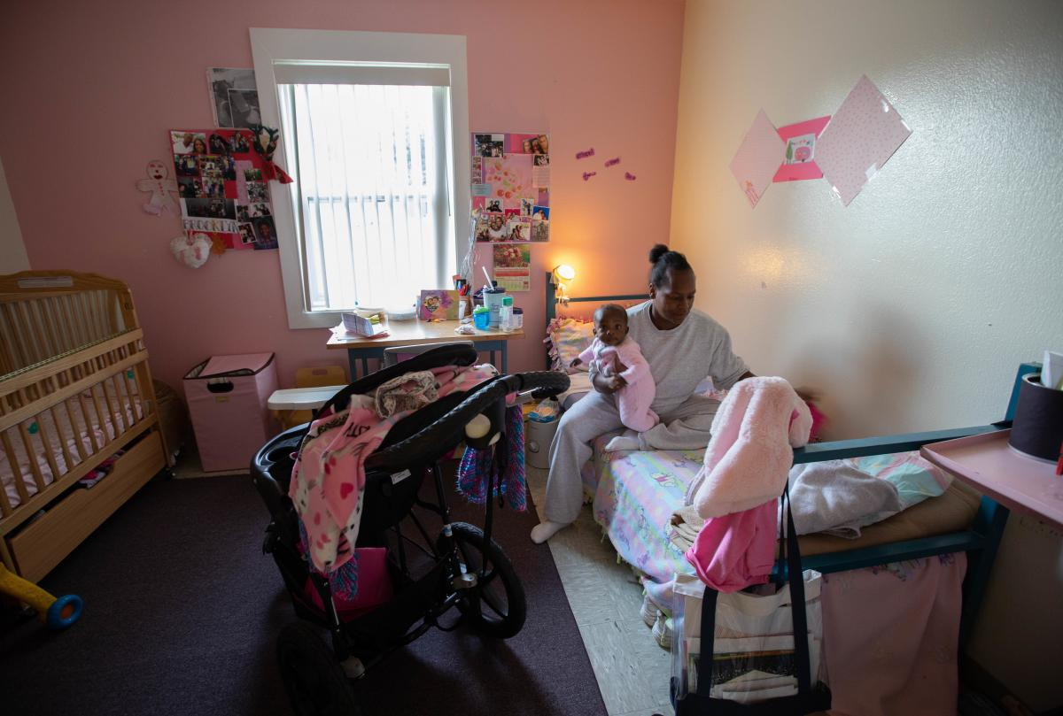 Daidre Kimp prepares for the day. She'll get daughter, Stella,  ready for daycare. The residential program selects up to 20 women to participate.