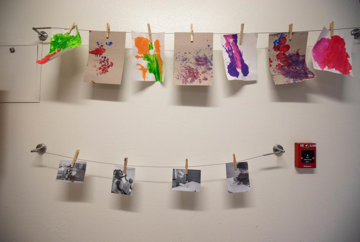 Toddlers' crafts and photos are displayed at the in-prison daycare.