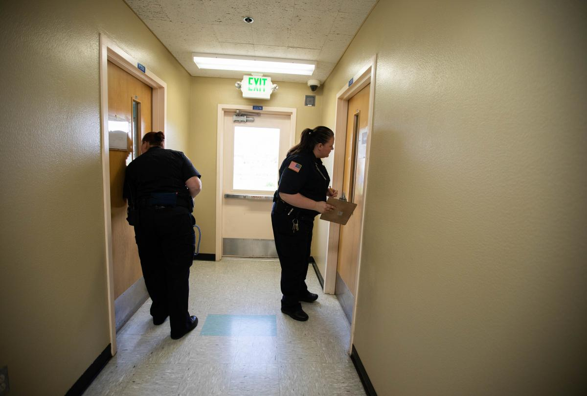 Correctional officers count inmates at the Women's Residential Parenting Program in Washington's correctional center in Gig Harbor.
