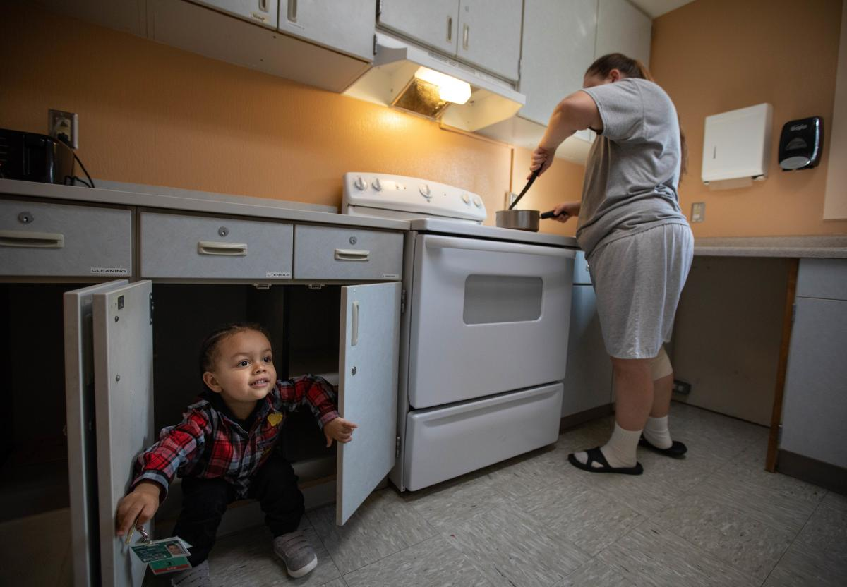 Crystal Lansdale cooks dinner for 2-year-old son, Kirshawn. Incarcerated mothers can purchase food and prepare meals for their kids. They receive state and federal assistance for low-income women, such as WIC (the nutrition program for Women, Infants and
