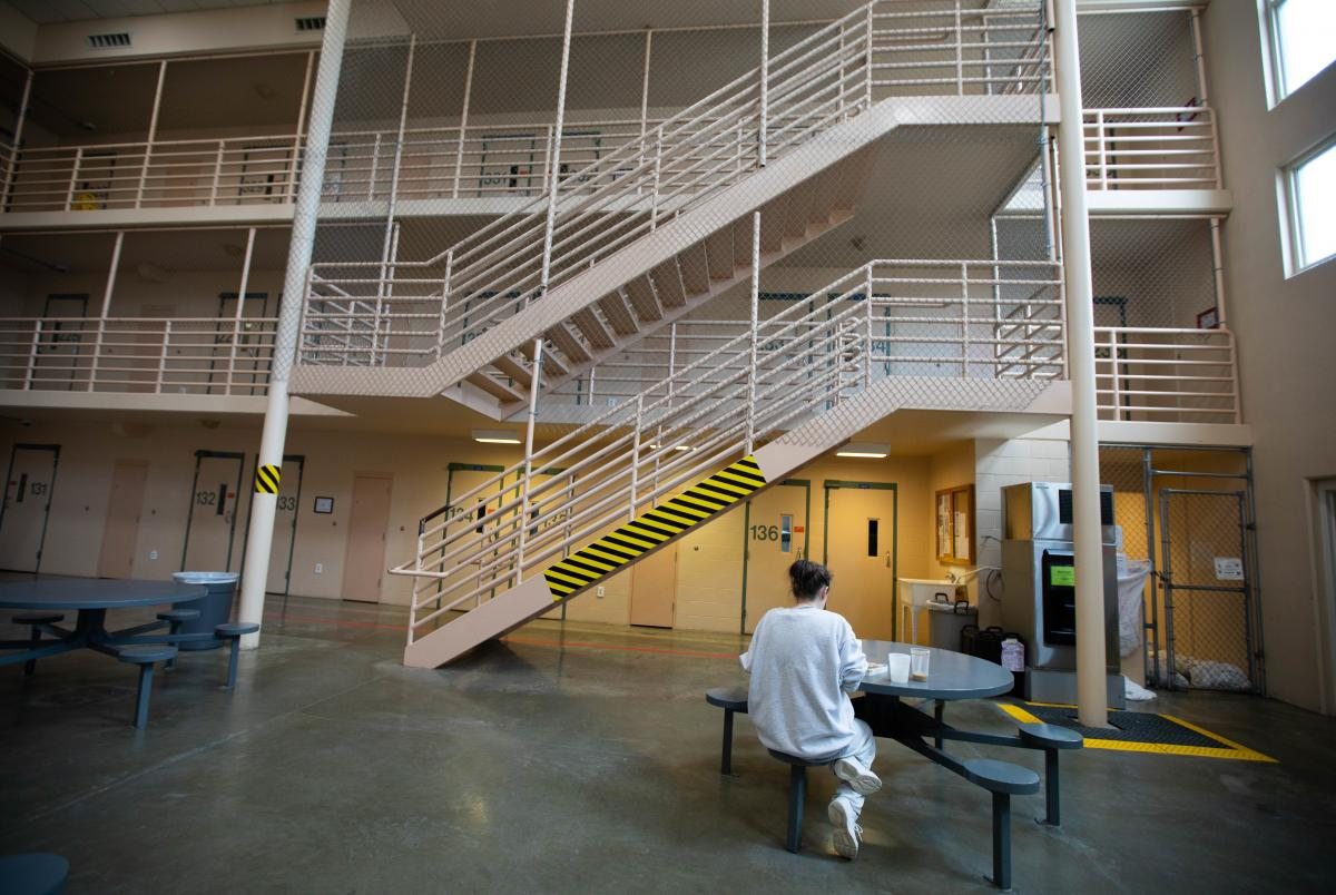 A female inmate eats a snack inside a maximum security unit. Their cells are more stark than the rooms used by the moms in the residential program.