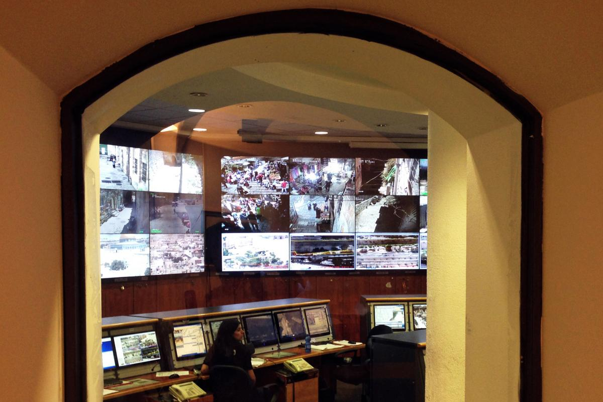 The screen room inside an Israeli police station. Feeds from the more than 330 cameras currently installed throughout the Old City are monitored here.