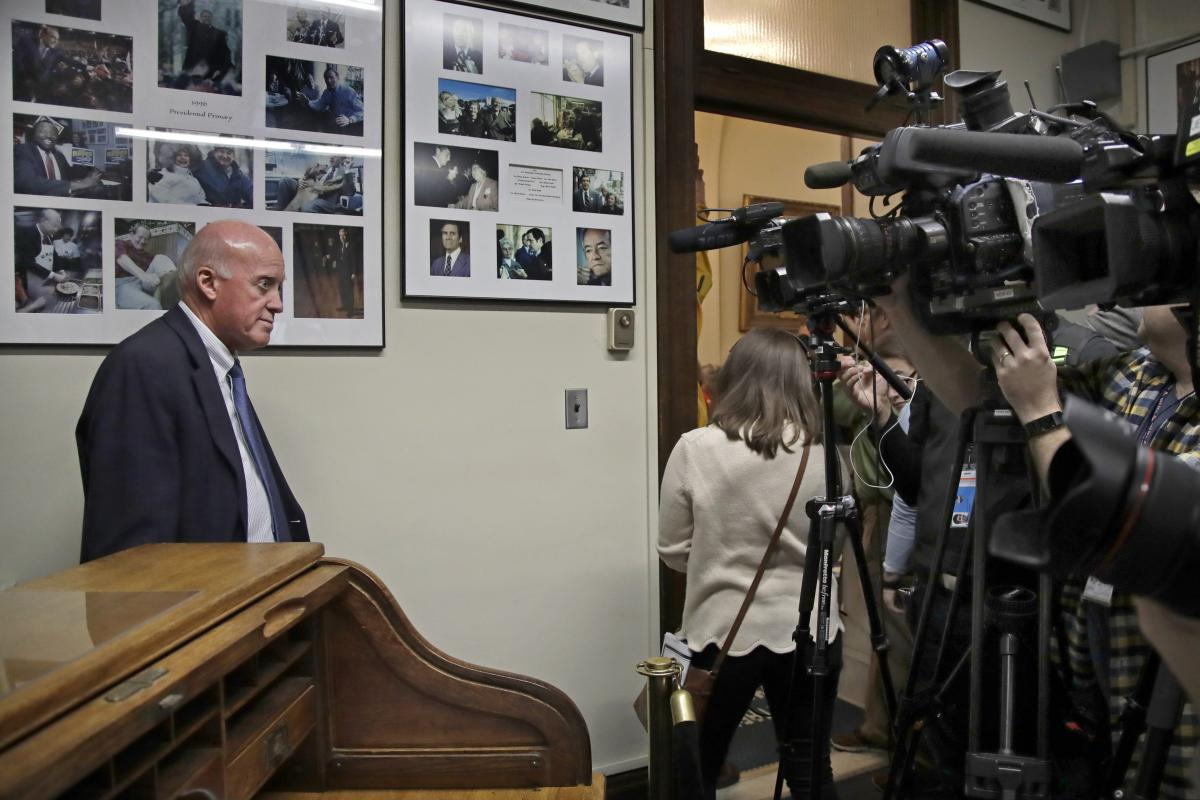 New Hampshire Secretary of State Bill Gardner, left, as he waits for a presidential candidate to to file to be placed on the New Hampshire primary ballot. Gardner is the long-serving top election official in the country and has been accused of downplaying