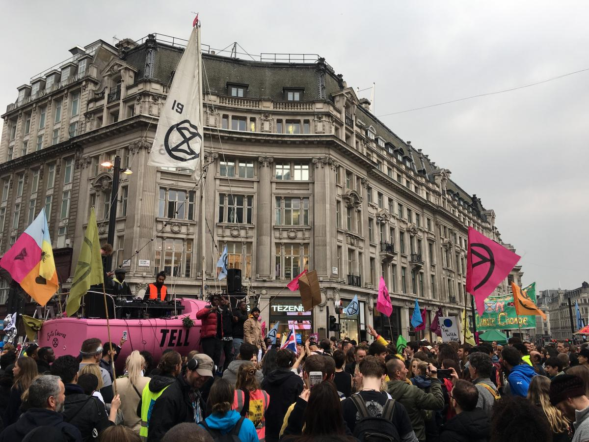 A pink sailboat at a tent camp blocks traffic in London's Oxford Circus on Tuesday. Protesters chose a sailboat to illustrate the threat of rising waters. They want Britain to reduce greenhouse gas emissions to net zero by 2025.