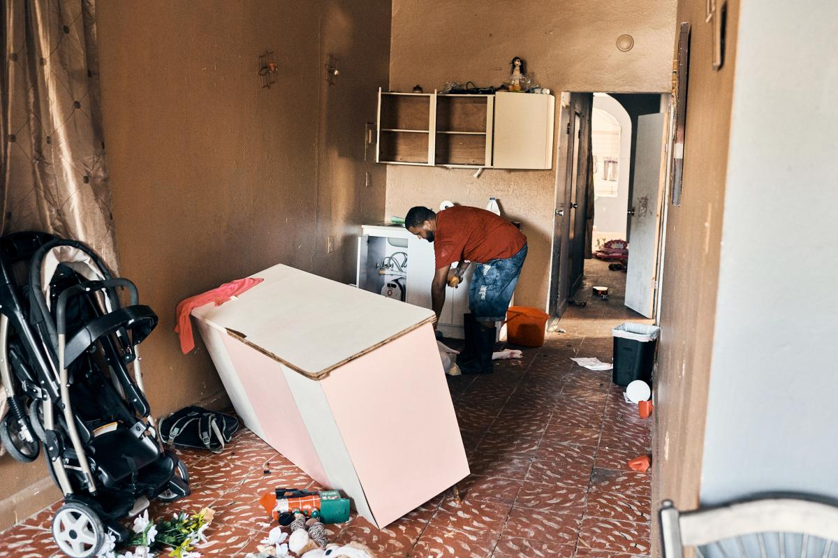 Luis Martínez Torres and his family of six evacuated their home in Guanica on Tuesday. The foundation showed signs of cracking and all of their belongings were violently thrown around the house.