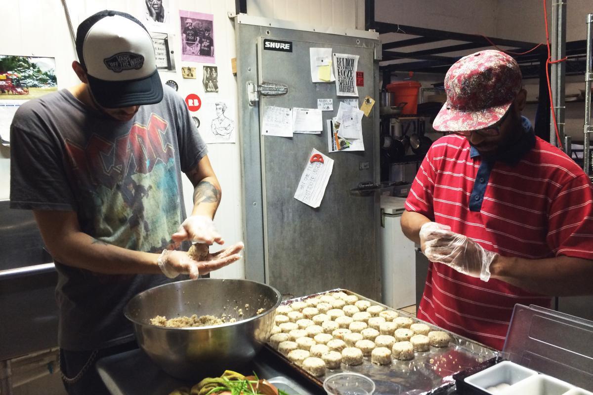 Roberto Diaz and Manuel Vasquez prepare croquettes made from green bananas and quinoa in the kitchen of El Departamento de la Comida, a farmers market and restaurant in San Juan.