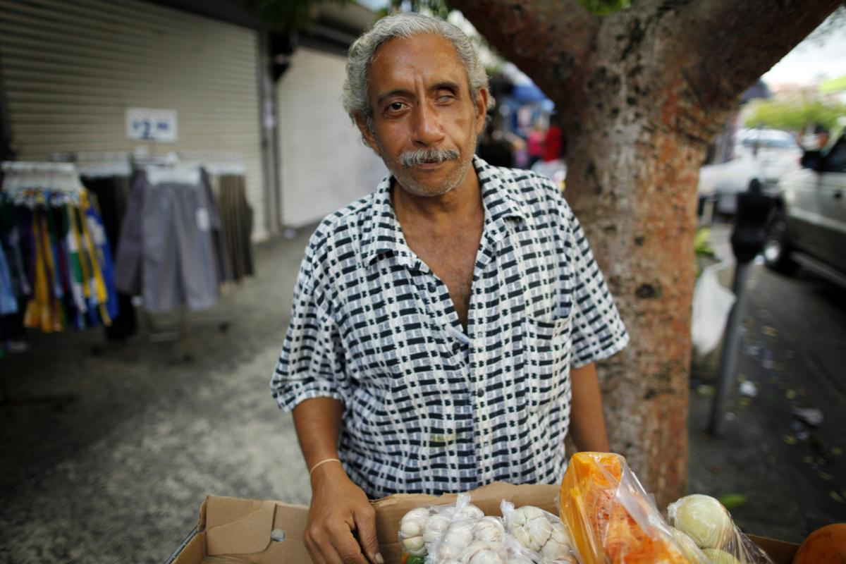 Miguel Sanchez sells fruits and vegetables on the street in Rio Piedras.