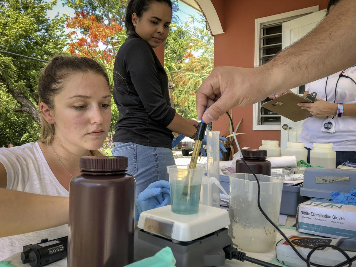 Graduate student Melanie Warren and laboratory technician Taina Rodriguez Curet work with Fernando Rosario-Ortiz to test tap water samples in Puerto Rico for lead. Initial results suggest potentially dangerous levels of lead in some drinking water that Ro