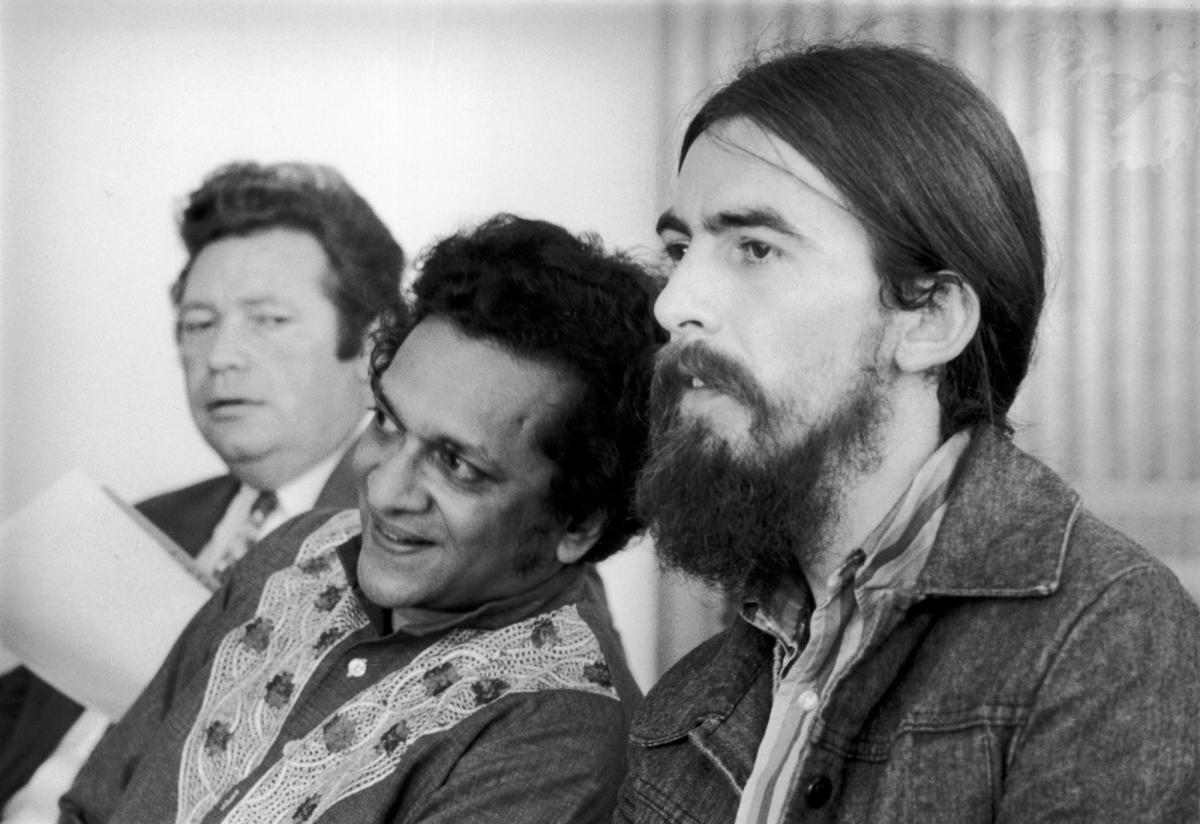 December 1971: Singer-songwriter George Harrison at the Royal Festival Hall with Indian sitar maestro Ravi Shankar, during the time Harrison helped to organize the 'Concert for Bangladesh'.