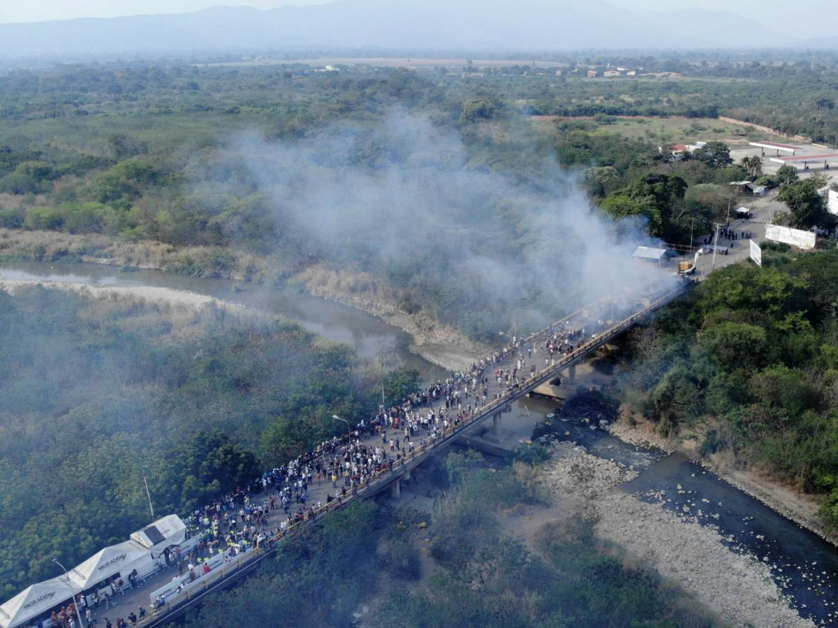Smoke billows from aid trucks set on fire on the Francisco de Paula Santander International Bridge between Colombia and Venezuela, on Feb. 23.