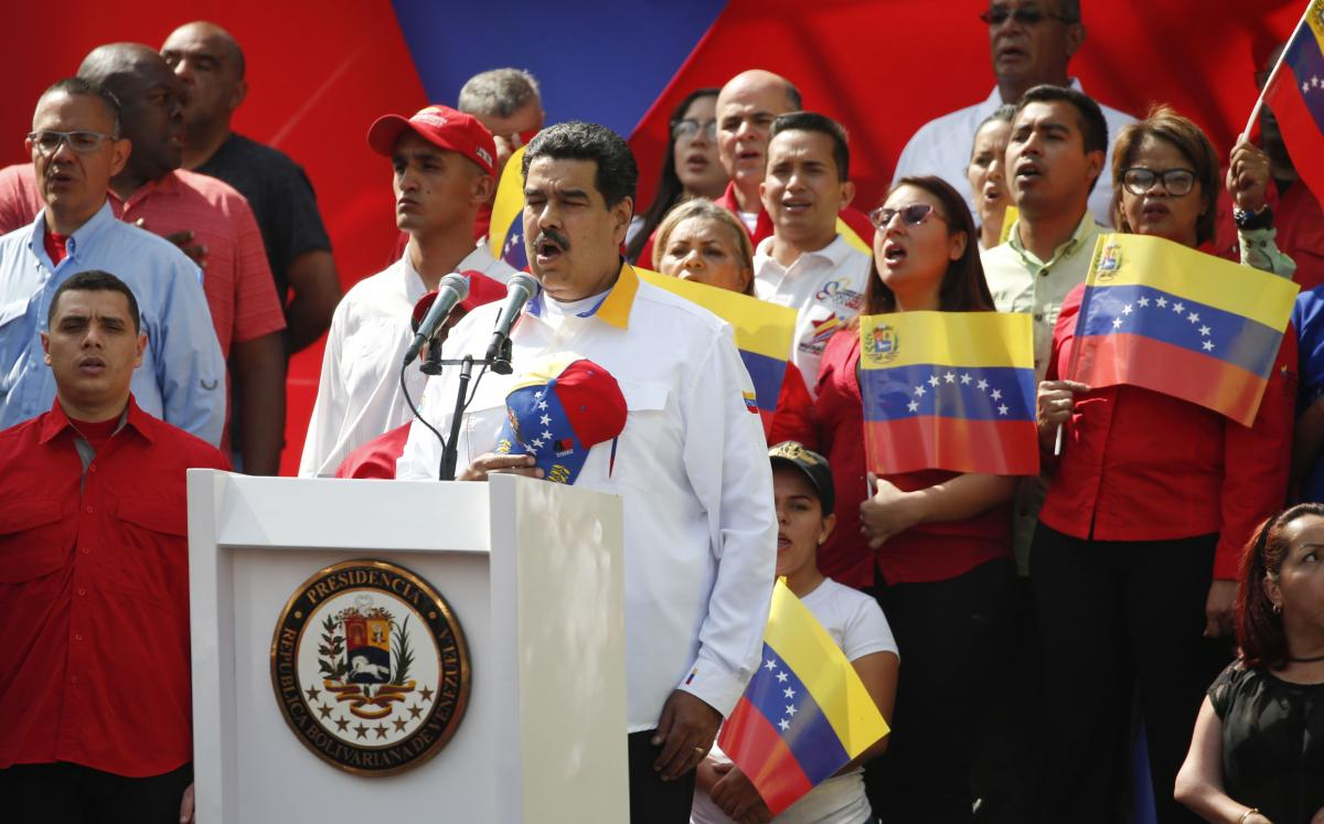 Venezuela's President Nicolás Maduro sings the national anthem during a rally in Caracas, Venezuela, on March 23.