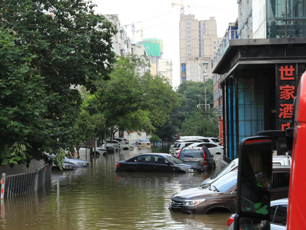 As of Sunday, streets remained submerged in the city of Xinxiang, in China's Henan province. Heavy rains flooded the city and a nearby river.
