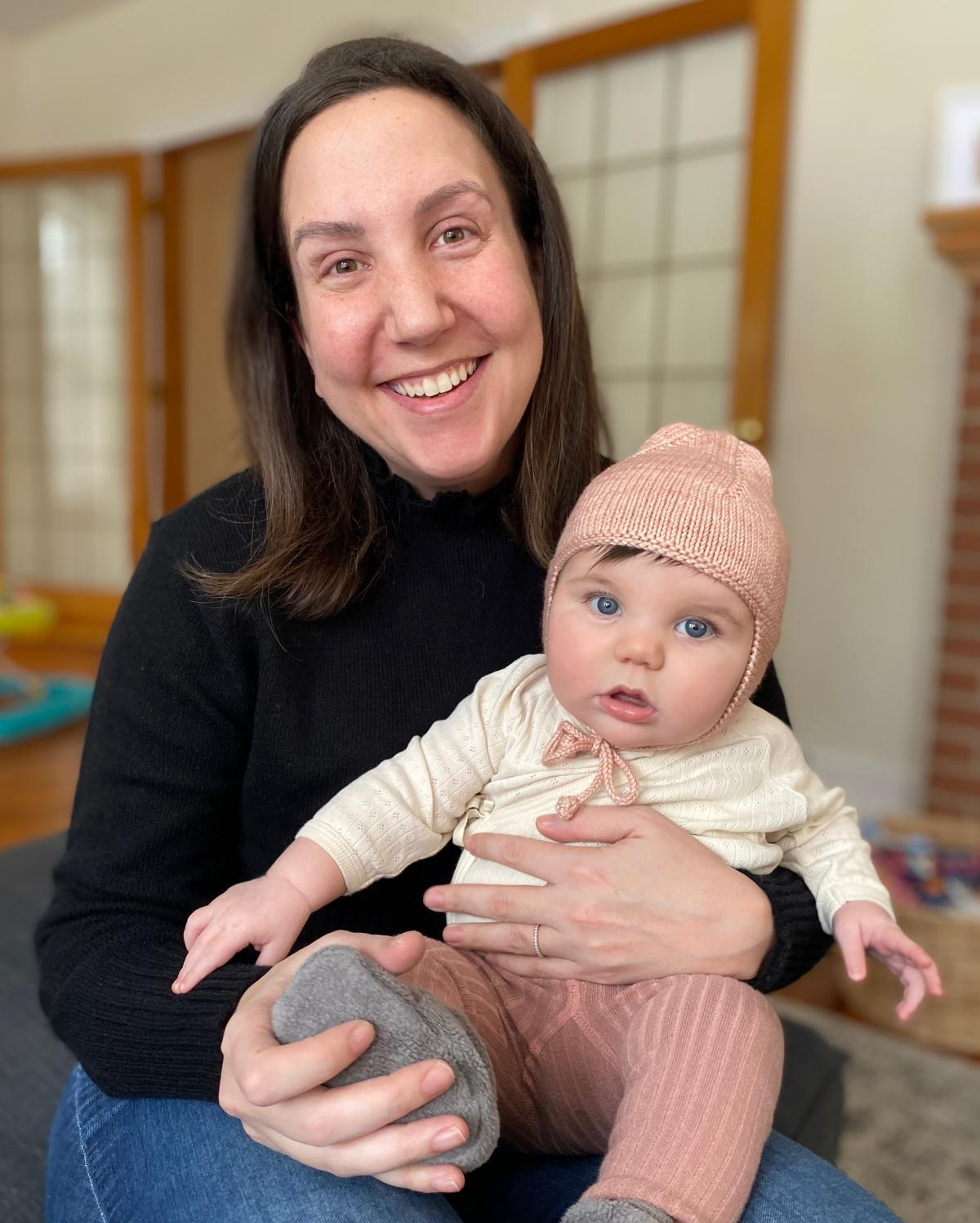 Sheera Talpaz, seen with her daughter Ruby, is buying her first house in Oberlin, Ohio. Low interest rates will make the mortgage payment lower than her previous rent in California, Talpaz says.