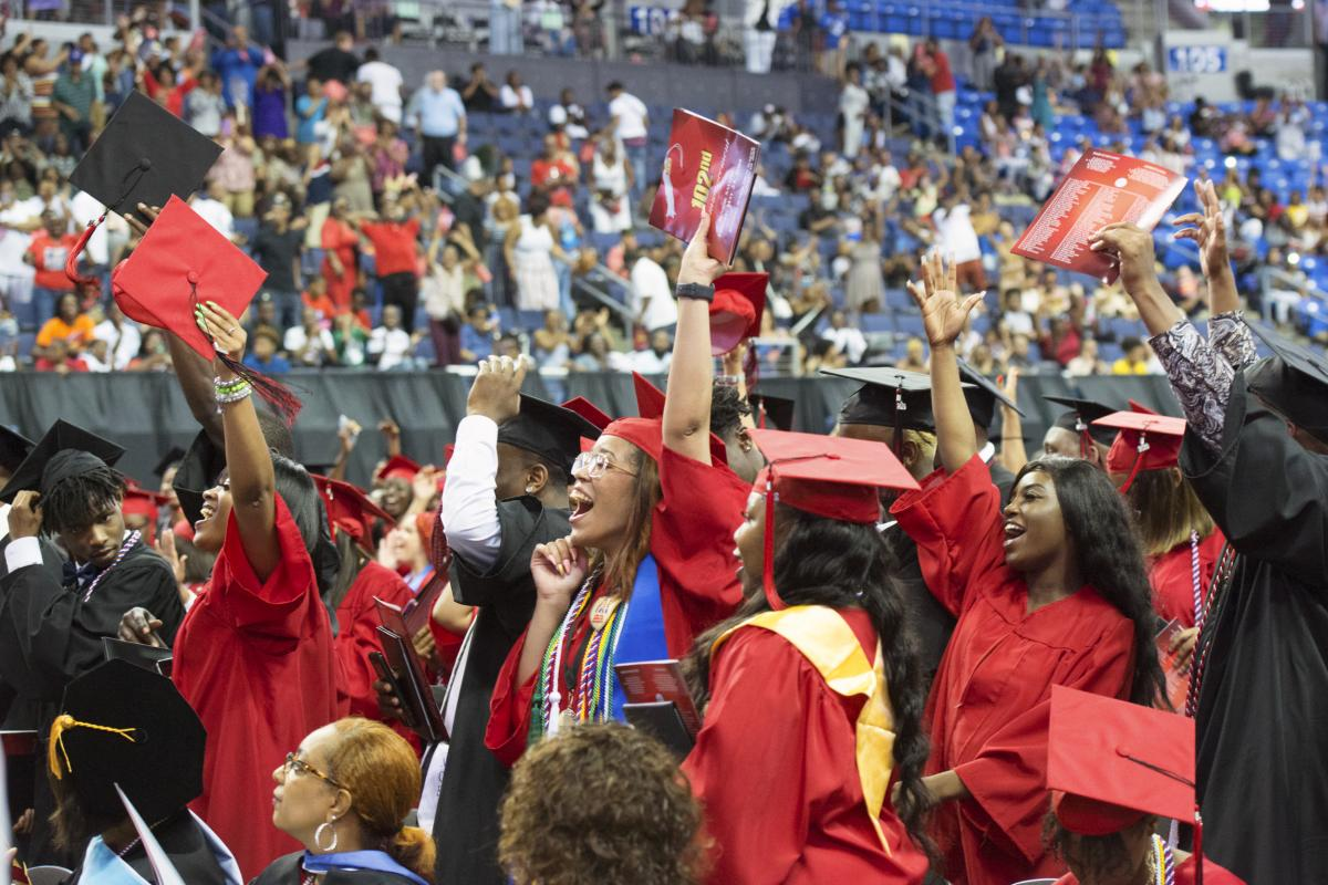 Students cheer their class of 2019 at Jennings High School, during their graduation ceremony at the Chaifetz Arena in Saint Louis, Mo.