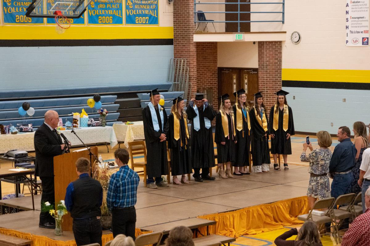 A Tiny Ceremony: Superintendent Charles Auzqui, left, congratulates the small graduating class at Clearmont Elementary, Arvada-Clearmont Junior and Senior High School in Clearmont, Wyoming.