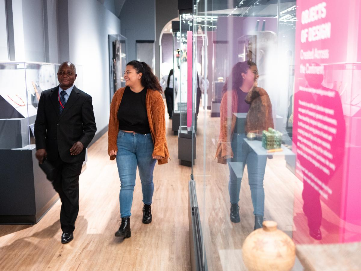 Clay Katongo, left, was born in the Democratic Republic of the Congo and is a guide for the Penn Museum's Africa Galleries. Celeste Diaz, who traveled back and forth with her family between Guatemala and Texas, works in the Mexico and Central America Gall