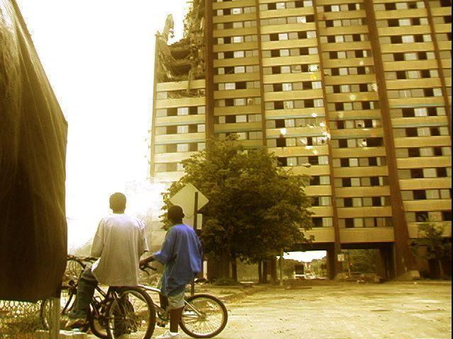 This still from the documentary film East of Liberty shows two young boys in Pittsburgh looking up at a building facing demolition.