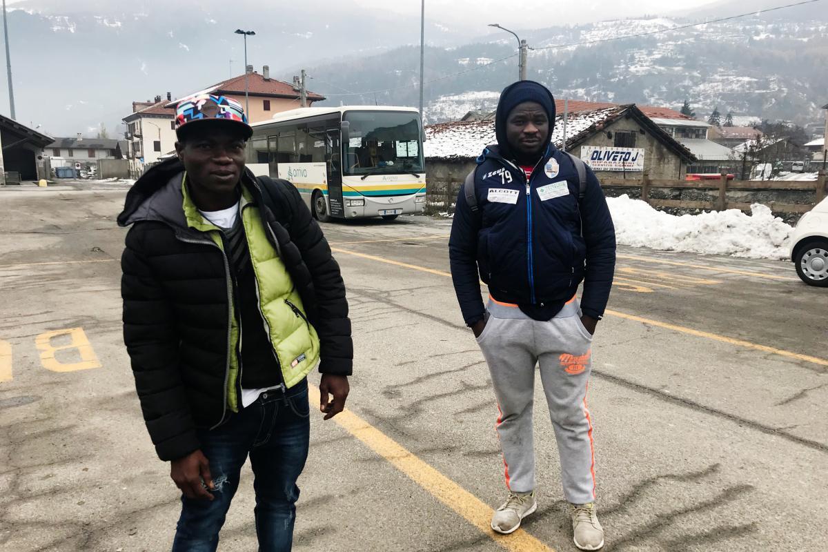 Harouna Waija (left) and Abdul Razak, both 22 and from Ghana, walk in the Italian Alps, near the French border.