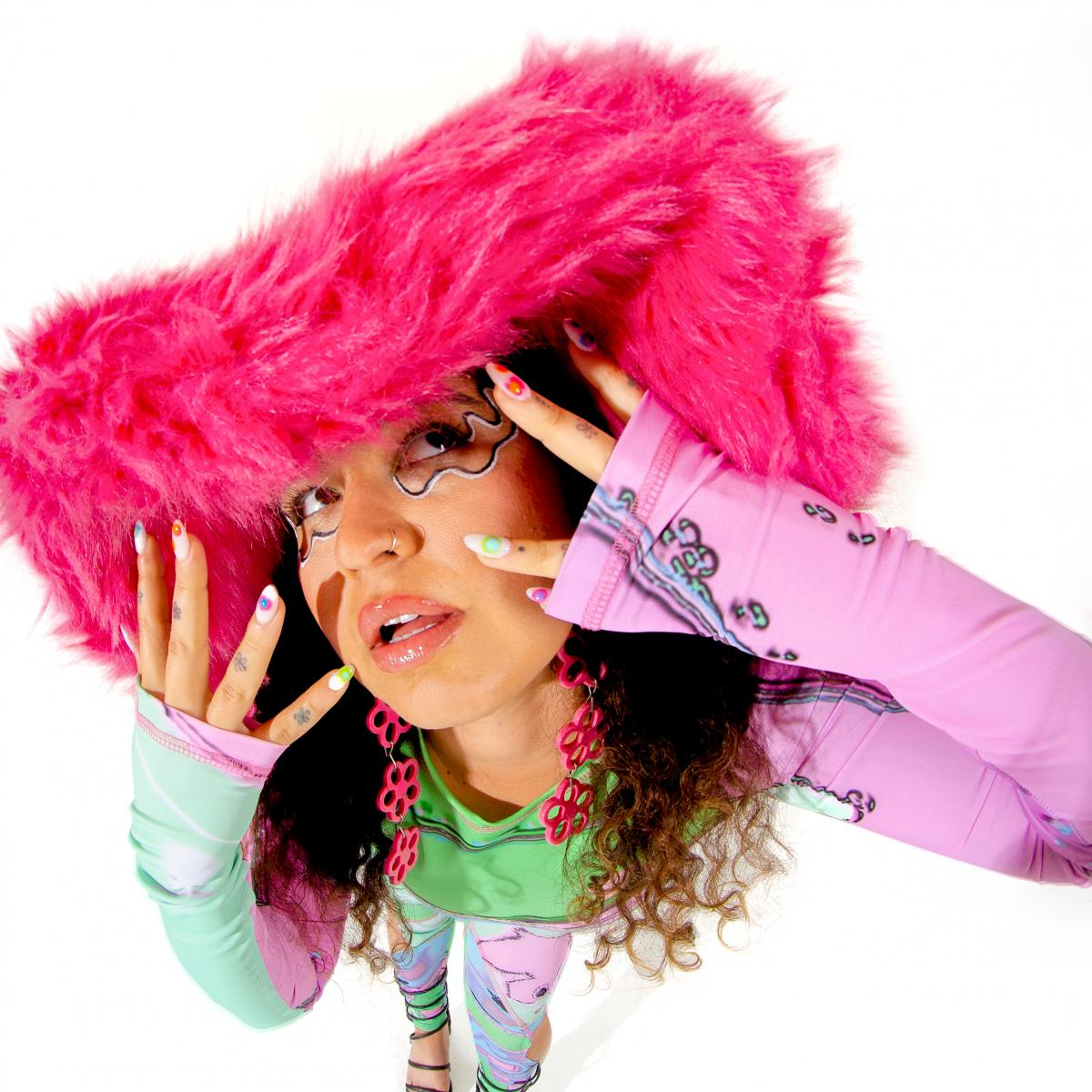 """Remi Wolf, singer behind the viral Tik Tok hit, """"Photo ID,"""" and fan of outrageous hats."""