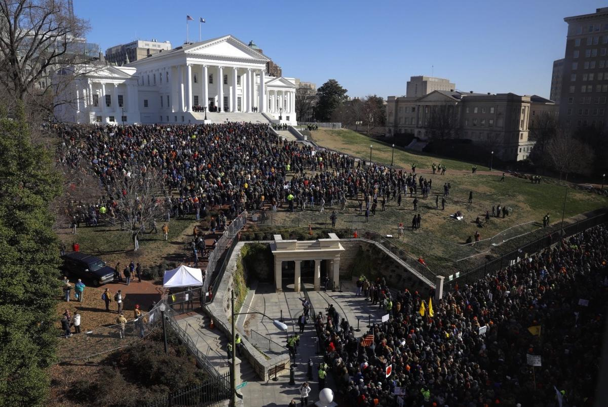 The rally featured a slate of speeches before those gathered on the lawn below the white-columned Capitol.