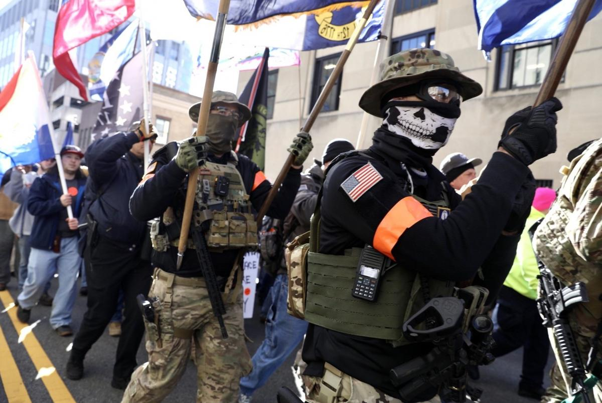 Militia groups from across the country march toward the rally.