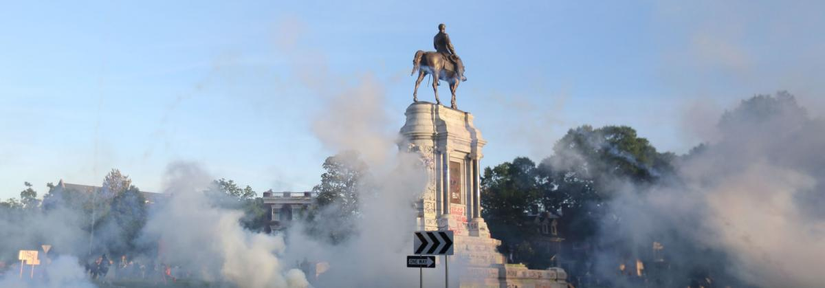 Tear gas clouds the air around the Monument Avenue statue of Confederate Gen. Robert. E. Lee on June 1, when Richmond police scattered hundreds of peaceful protesters by releasing tear gas and shooting pepper spray about 30 minutes before the 8 p.m. curfe