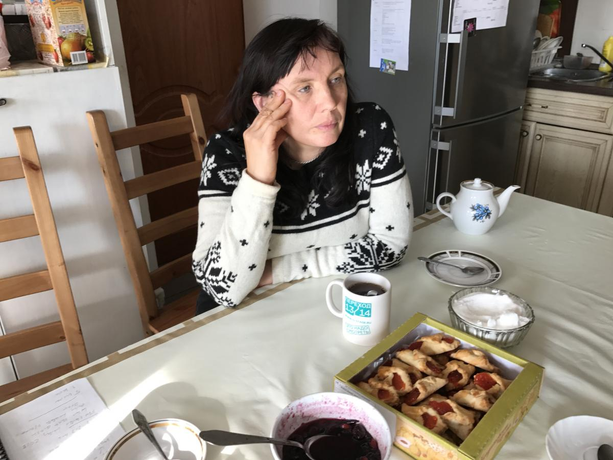 "Alyona Sadikova sits in the kitchen of the women's shelter she heads on the outskirts of Moscow. ""We try to get women back on their feet. This is not a hotel,"" she says. ""We're not saviors; we want women to save themselves."""