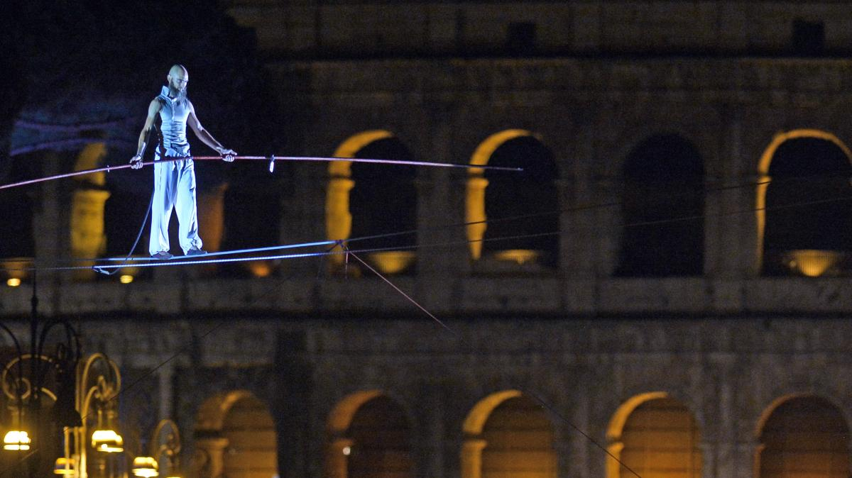 Tightrope walker Andrea Loreni performs in front of the Coliseum in Rome on Saturday. Rome's new mayor is on a crusade to make the ancient monuments more pedestrian friendly, and the city held an all-night street party as it permanently blocked off part o
