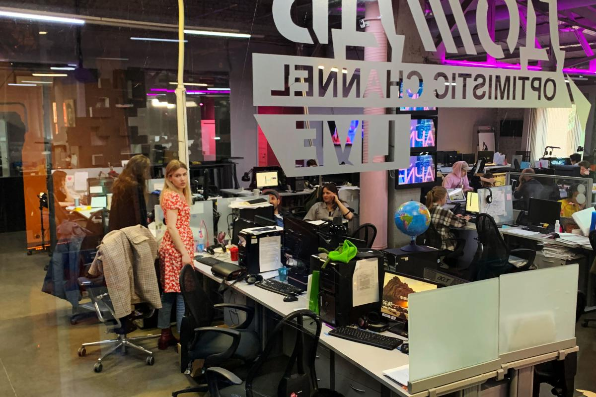 """Borzunova stands in the TV Rain newsroom. TV Rain, which at first called itself """"the optimistic channel,"""" has become an alternative to state television."""
