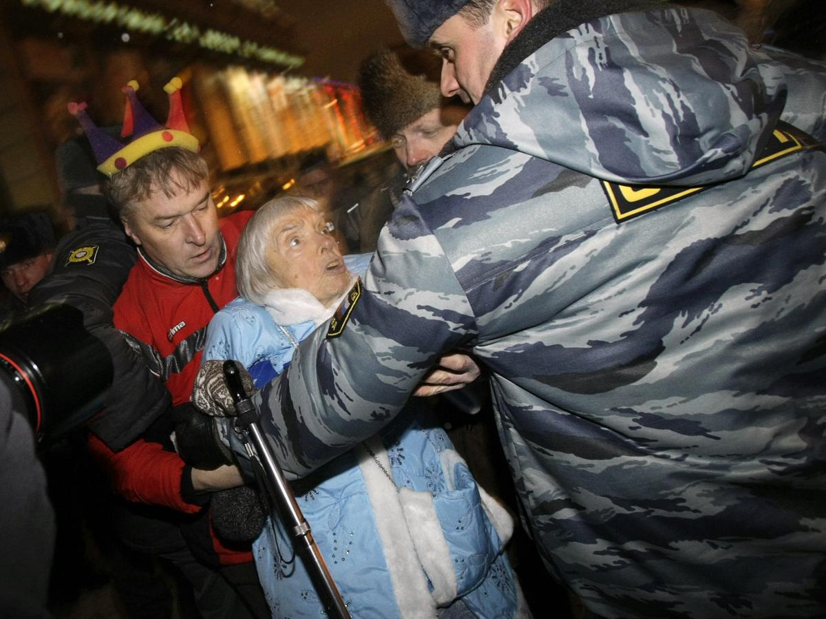 Police officers detain Alexeyeva during a New Year's Eve anti-Kremlin protest in downtown Moscow in 2009.