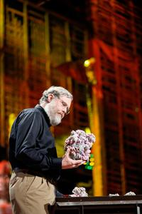 George Church, a professor of genetics at Harvard Medical School, seen looking at a molecular model, says an effort to create synthetic humane genomes could someday have medical applications.