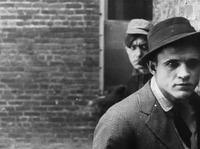 D.W. Griffith's The Musketeers of Pig Alley (1912) is thought to be the first gangster film.