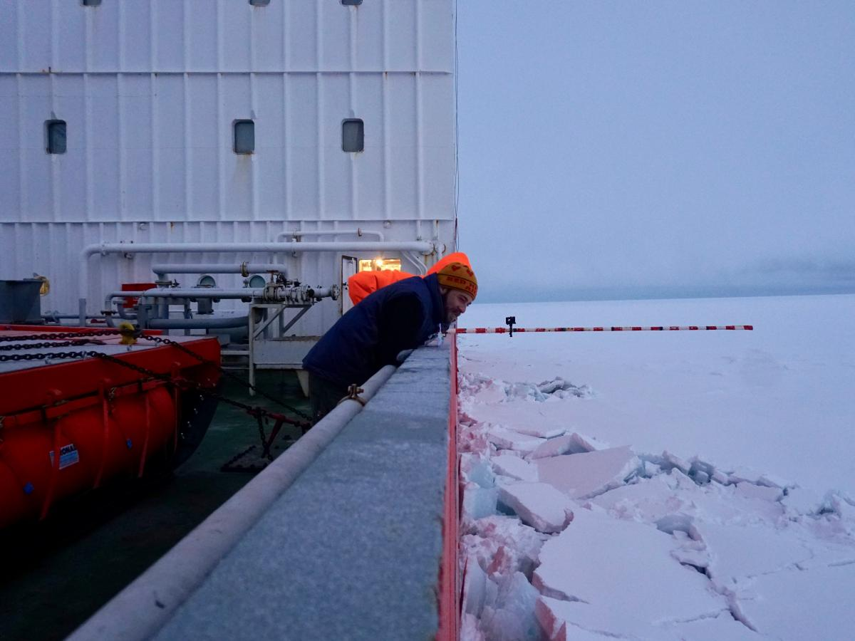 Ian Raphael watches as the Akademik Fedorov tests the thickness of an ice floe by driving through it.