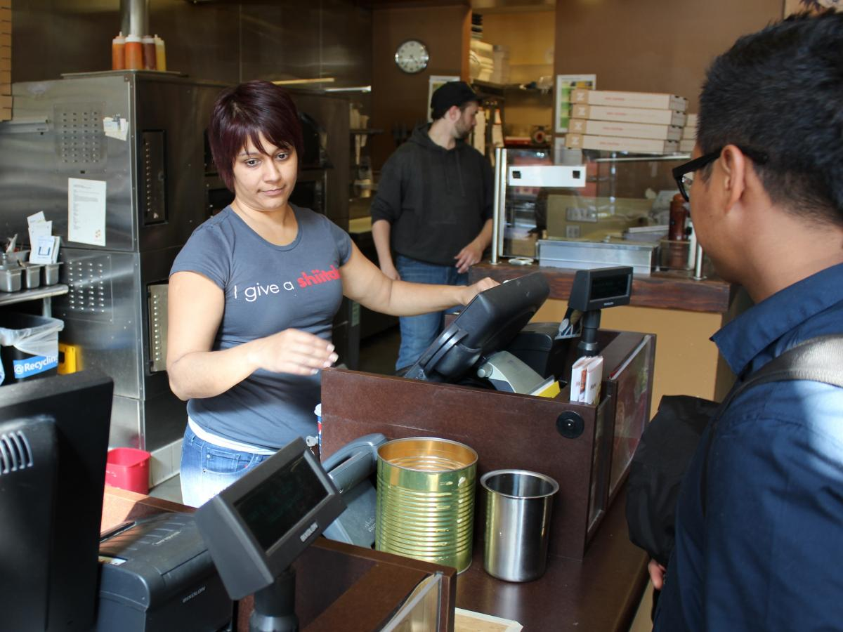 Ritu Shah Burnham owns a zpizza franchise in Seattle. She says she is closing her business because of the new minimum wage law, which mandates that she raise wages to $15 an hour by January 2017.