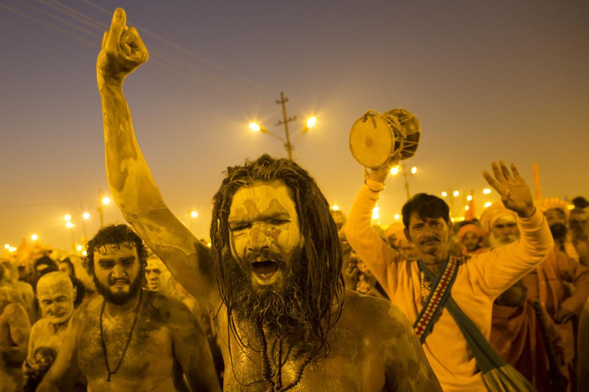 Naga sadhus, naked holy men, walk in procession after bathing on the auspicious day of Mauni Amavasya on Sunday.