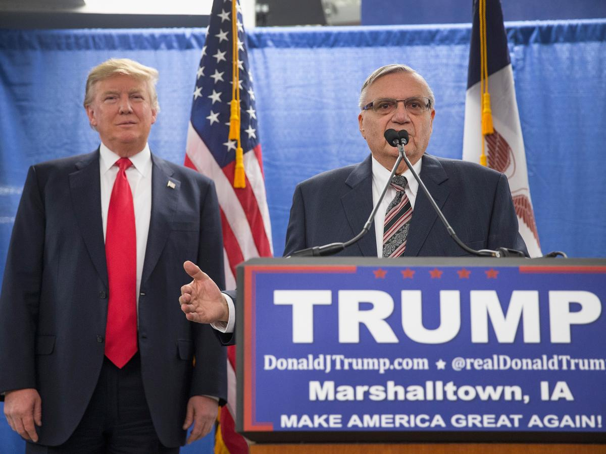 Sheriff Joe Arpaio of Maricopa County, Ariz., endorses Republican presidential candidate Donald Trump prior to a rally in January 2016 in Marshalltown, Iowa.