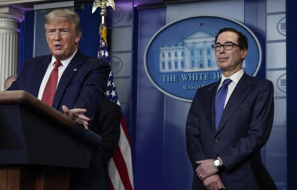 President Trump, joined by Treasury Secretary Steven Mnuchin, speaks during a briefing with the coronavirus task force.