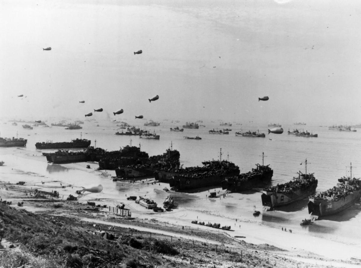 Barrage balloons and ships at Omaha Beach during the Allied assault in Normandy, France.