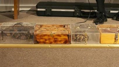 Boxes housing snakes sit on the floor of the Full Gospel Tabernacle in Jesus Name in Middlesboro, Ky.