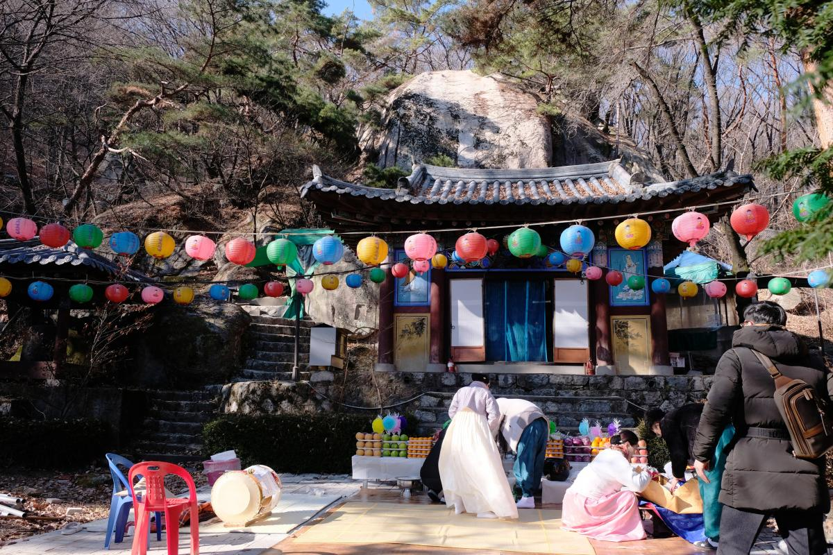 Participants clean up following a shamanic initiation ceremony at a temple in Seoul.