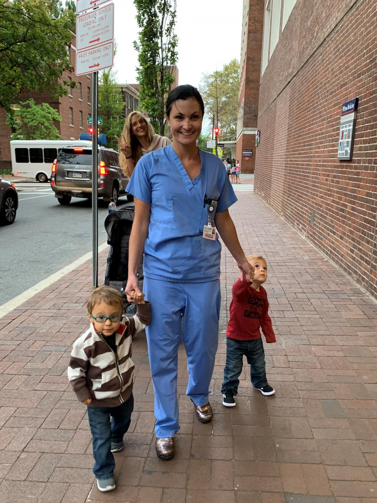 Dr. Lauren Jenkins walks with her two sons, Pierce and Ashton, in Philadelphia in the fall of 2019.
