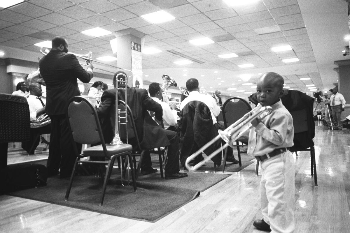 Cedric Mangum (left) leads a shout band as a junior member looks on.
